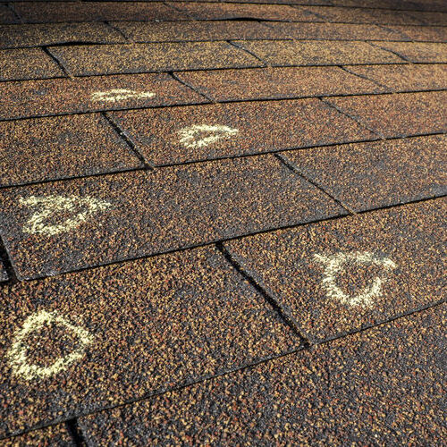 Roof Hail Damage Marked by an Adjuster.