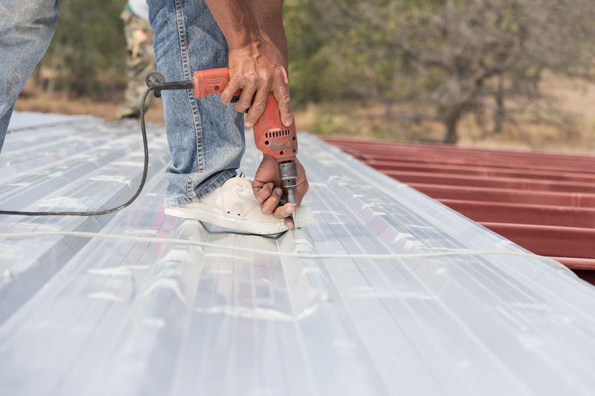Contractor Installing Metal Roofing